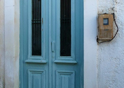 turquoise door electric meter greece