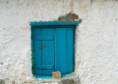 turquoise shutters village house Finikounda