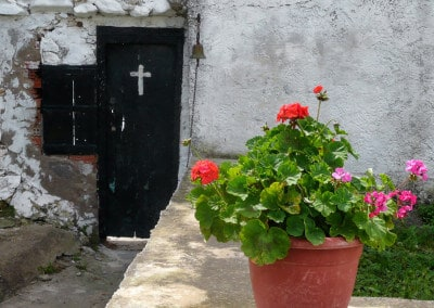 cross old door geraniums monastry