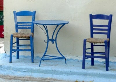 blue taverna chairs greece
