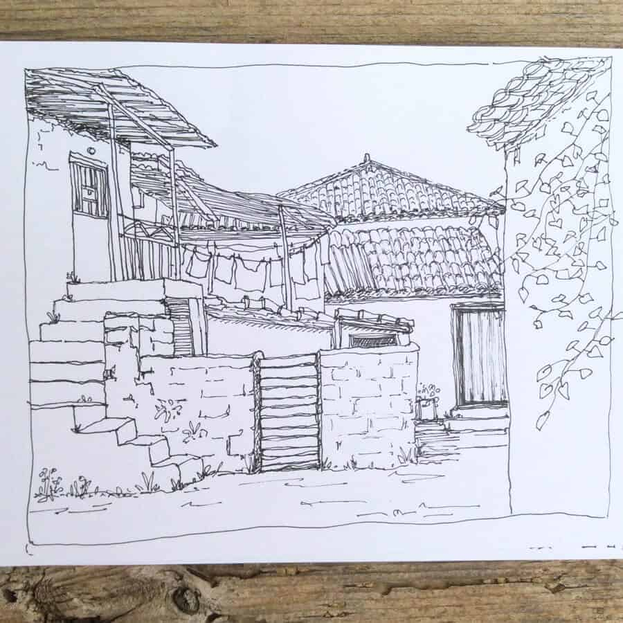 sketchbook page of line drawing in Greek village by Gill Tomlinson