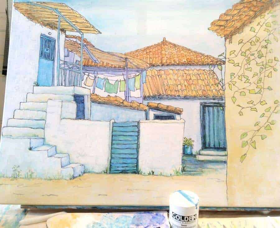 painting in progress of a village in greece