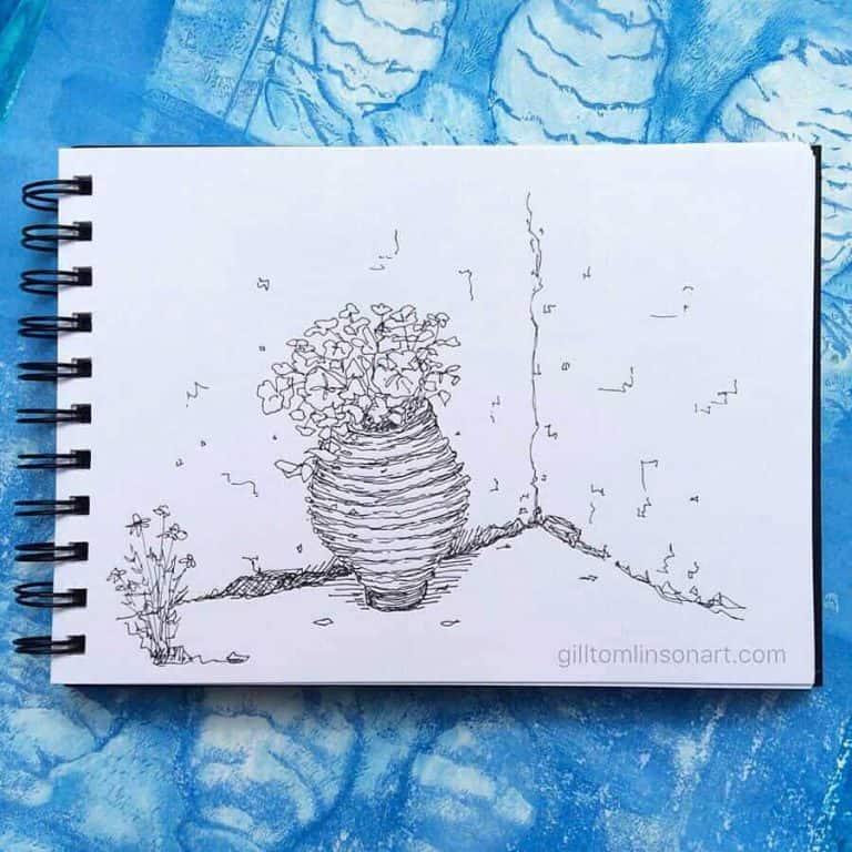 sketchbook drawing pot in greek village corner