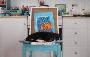 greek cat blue chair artists studio